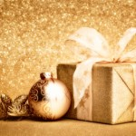 Image of gold christmas present with gold ornament