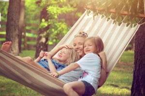 Mother in Hammock with two kids